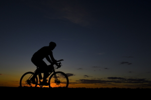 Cyclist riding at sunset