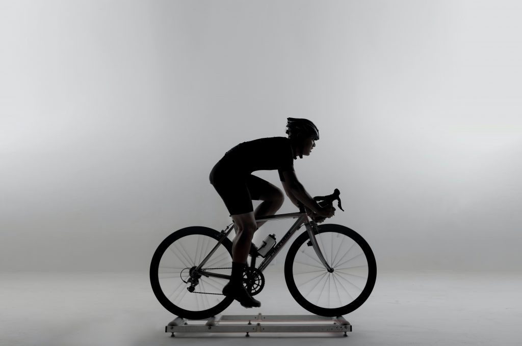 Cyclist using indoor turbo trainer rollers